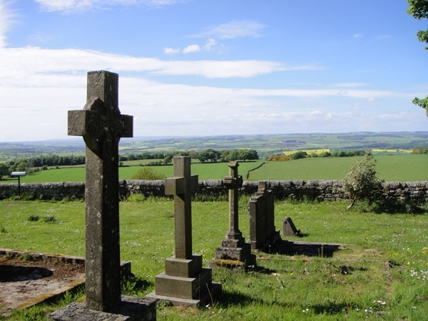 View across churchyard at St Oswald's