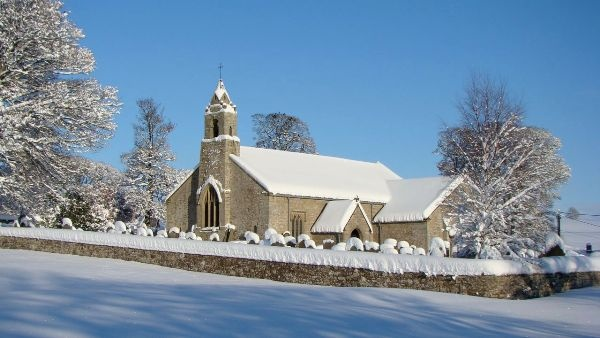Snowy St Cuthbert's on the Village Green